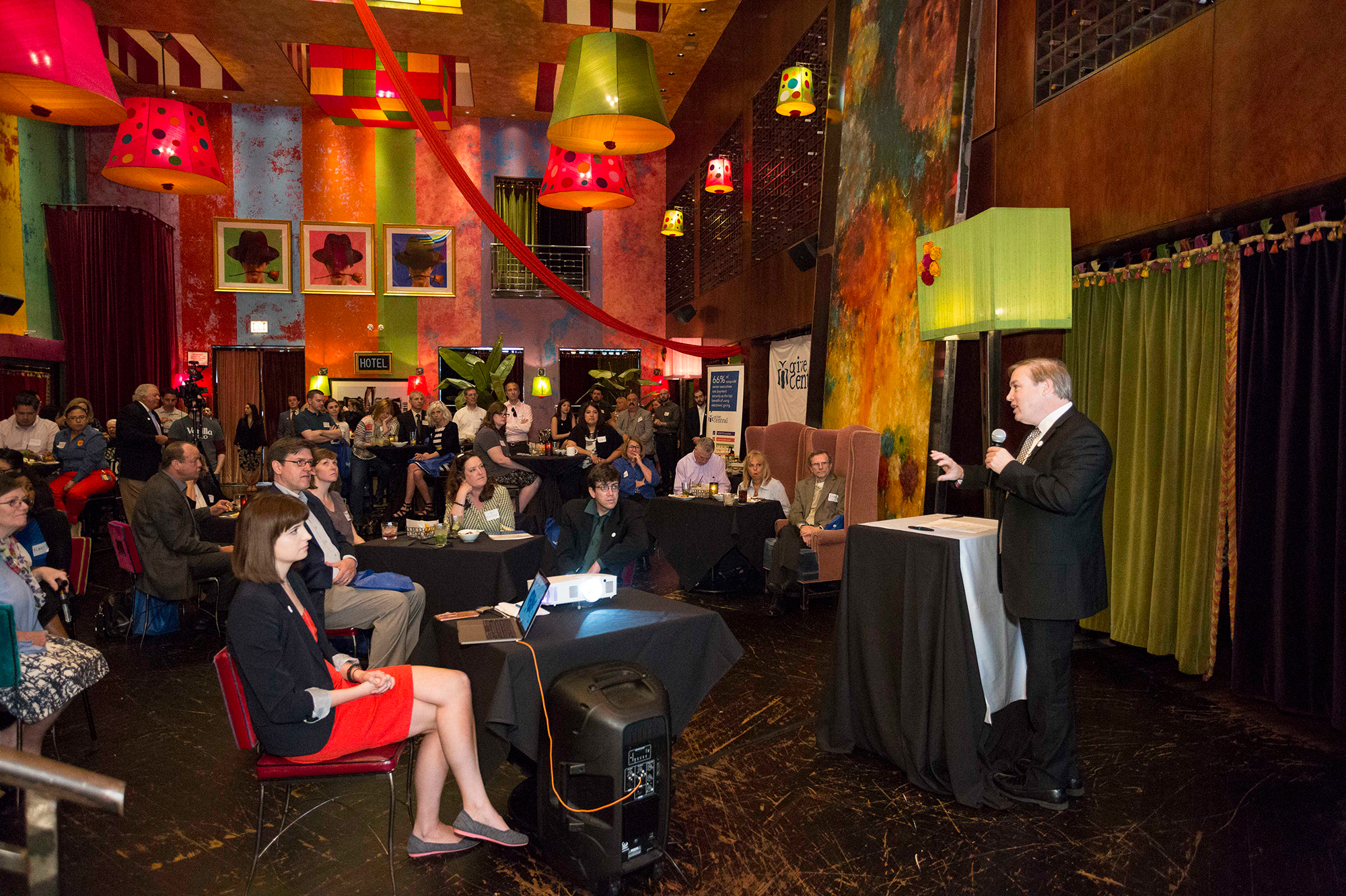 May, 2018, in Carnivale Restaurant, on Fulton Street in Chicago. In this image, you see Patrick explaining the benefits of the new Give Central program, provided by the Coleman Group.