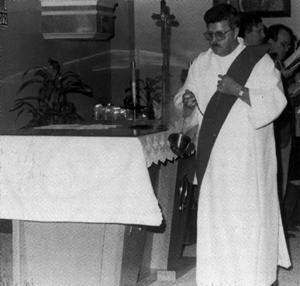 Deacon incensing the altar