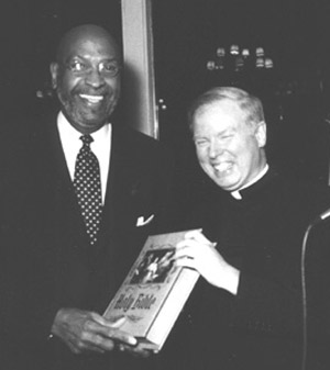 Warner Saunders and Father Michael Gilligan