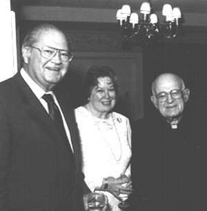 Professor Richard Michael, Mary Michael, and Father Matt Hoffman