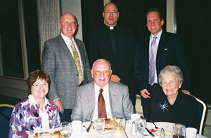 From the left, seated, are Liz Fagan, Joe & Bobbie Noonan; standing are Dr. Mike Fagan, Father Jim Heyd, and Jerry Bern. Father Heyd is a pro-life advocate of the Chicago Archdiocese. He introduces Coleen Mast and speaks of her good works.