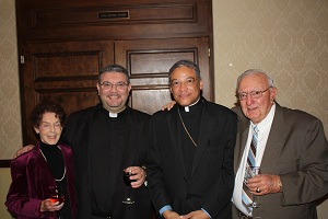 Bishop Joseph Perry with Father Simonetti and his parents.