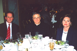 Jerry and Chris Bern, with Father Pat Lagges