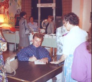 Dan Schutte signing his name