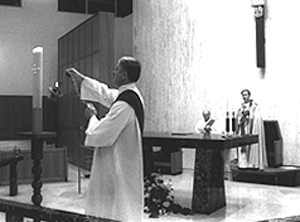 Ray Deabel (left) incenses candle at beginning of Vespers