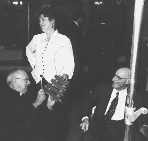 Father Charles Kouba, Evie Hanson, Frank Termini