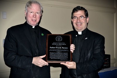 Father Michael Gilligan, conferring the Henry Hyde Award on Father Frank Pavone