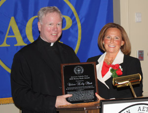 Coleen Mast (right) is presented with the ACP Henry Hyde Award for 2010, for her writing and broadcasting on a pro-life theme.
