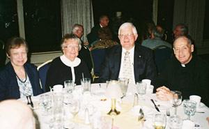Darlene Ruhl, Beth Ehlman, Pete Ruhl, and Father Jim Flynn
