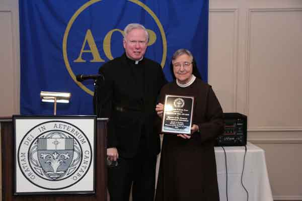 Sister Jane Klein receiving the Gratiam Dei Award
